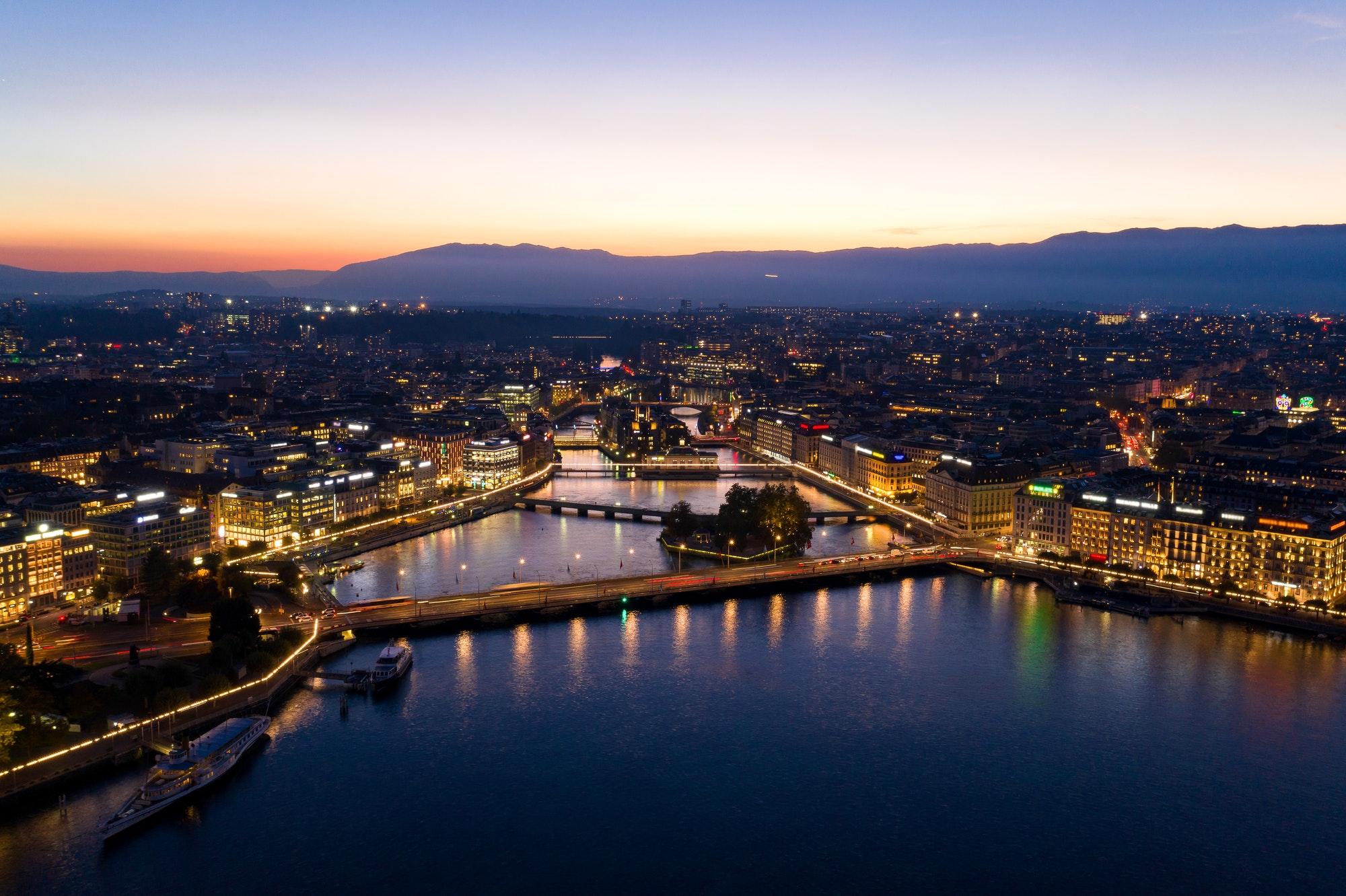 Aerial night view of Geneva city waterfront skyline in Switzerl